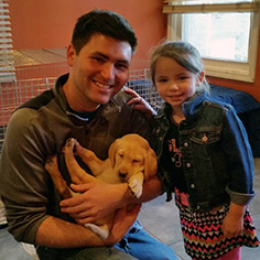 father and daughter with new puppy